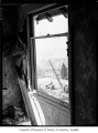 Looking out window of house at freeway construction, probably in Seattle, 1960