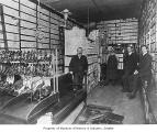 Wallin & Nordstrom shoe store interior showing company staff in a showroom corner, Seattle,...