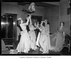Ben Paris wedding showing bridesmaids catching bouquet, possibly in Seattle, 1945
