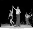 Don Cockell declared the victor after knocking out Harry Kid Matthews at Sick's Stadium in...