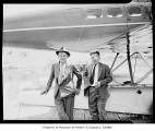 Will Rogers and Wiley Post beside their airplane, Renton Field, August 1935