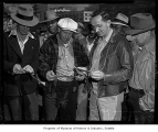 Longshoremen with checks for back pay, Seattle, September 9, 1946