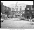 Razing College Club building at Sixth Avenue and Spring Street prior to freeway construction,...