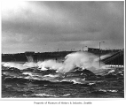 Waves crashing against Evergreen Point Bridge during a storm, Medina, 1970