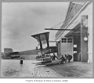 Men pulling B & W into Boeing Seaplane Hangar on Lake Union, Seattle, 1916