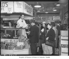 Customers waiting to buy butter at Shepherd's Grocery, Seattle, 1943