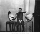 Jack Hennessey with his roosters, Seattle, January 3, 1928