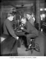Seattle Police Chief Louis J. Forbes at telephone switchboard, Seattle, 1930
