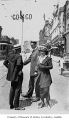 Police officer Albert Julius Hansen with traffic signal and pedestrians, Seattle, ca. 1935