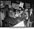 Warren Magnuson and Democratic Party National Convention delegates with a donkey, 1956