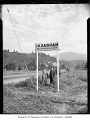Earl Bramble and Alfred Keogh with new sign, Issaquah, August 17, 1948