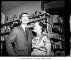 Wing Luke and his mother inside a store, probably in Seattle, 1962
