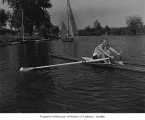 Bill Tytus, rower for Lake Washington Rowing Club, in a shell and rowing at sea, probably in...