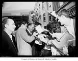 Elvis Presley and Governor Rosellini signing autographs, Seattle, September 5, 1962