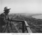 Man wearing hardhat on KOMO radio tower, Seattle, 1948