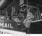 Aviator Herbert Munter and three women with mail plane, probably in Seattle, 1932