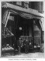 Wallin & Nordstrom shoe store with Carl Wallin and John Nordstrom outside front entrance,...