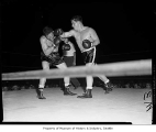 Don Cockell throwing a right at Harry Kid Matthews during their fight at Sick's Stadium, Seattle,...
