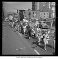 Protestors march across Spring Street demonstrating opposition to freeway construction, Seattle,...