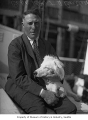 Arctic explorer Captain Robert H. Bartlett with dog, probably in Seattle, ca. 1928