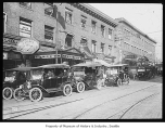 Jitney buses lined up on street, Seattle, 1918