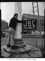 Al Minugh about to climb the flagpole near Suzzallo Library, University of Washington, Seattle,...