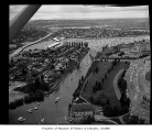 Aerial of yachts on parade through Montlake Cut on opening day of boating season, looking...