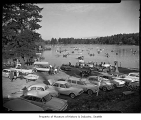 Opening day of trout fishing season showing a busy boat launching, probably in Seattle, 1962