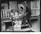 Katherine Pearson, Grace Gaudy, and John Lovgren with linen tea towels outside a home near Lake...