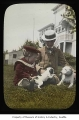 Charles and James Clise with puppies, Redmond, ca. 1905