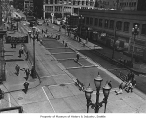 Third Avenue pavement after streetcar tracks were removed, Seattle, 1943