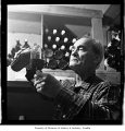 Angelo Pellegrini pouring wine, probably in Seattle, 1965