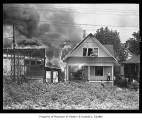 H.& F. Mill Company fire spreading to a neighboring house, Seattle, 1942