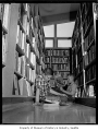 Boys reading in stacks of Burien Public Library, Burien, 1961
