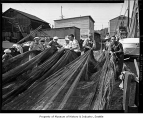 Crew of sardine fishing boat 'Margaret F.' pulling nets, probably in Seattle, 1949