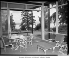 Home of University of Washington President Charles Odegaard, interior view showing sun room and...