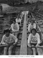 Women's crew team in shell and viewed close up, University of Washington, 1949