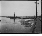Log rafts near Ballard Bridge, Seattle, ca. 1919
