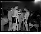 Don Cockell weighing in with Harry Kid Matthews looking on before their fight at Sick's Stadium,...