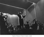 Milton Katims conducting Seattle Symphony Orchestra probably at the Seattle Center Opera House in...