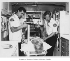 Medics and patient model inside Medic One unit, Seattle, 1971