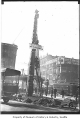 Pioneer Square totem pole being cleaned, Seattle, ca. 1923