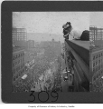 Women watching naval parade from roof, Seattle, 1908