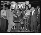 Warren Magnuson behind a donkey with Democratic Party National Convention delegates, 1956