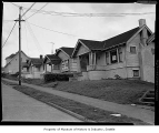 Homes to be removed for freeway construction, probably in Seattle, 1958