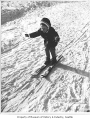 Girl skiing on bunny hill at Snoqualmie Summit, 1964
