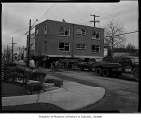 Apartment house at N.E. 68th Street and Weedin Place being moved prior to freeway construction,...