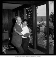 Jim Whittaker embraces Nawang Gombu, Seattle, 1963