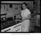 Frances Martin or Prudence Penny in a kitchen cooking, Seattle, 1938
