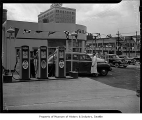 Gilmore service station showing attendants and a taxi near the gasoline pumps, Seattle, n.d.